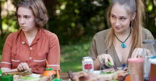 Hannah and Jessa eating rabbit